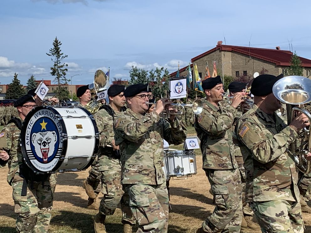 Members of the 9th Army Band march across Pershing Field at Joint Base Elmendorf-Richardson. (Jeff Parrott / ADN)
