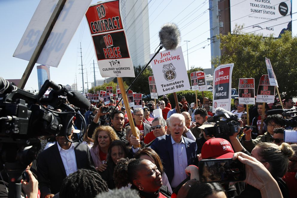 FILE - In this Feb. 19, 2020, file photo, Democratic presidential candidate, former Vice President Joe Biden calls out as he walks on a picket line with members of the Culinary Workers Union Local 226 outside the Palms Casino in Las Vegas. If Nevada has one job in the Democratic primary, it's to offer something different. And in many ways it has delivered. As the presidential race turned to the state this week, gone was the earnestness of Iowa and tradition of New Hampshire and in its place was racial diversity, a new unpredictability and the muscle of urban, union politics. (AP Photo/Patrick Semansky, File)