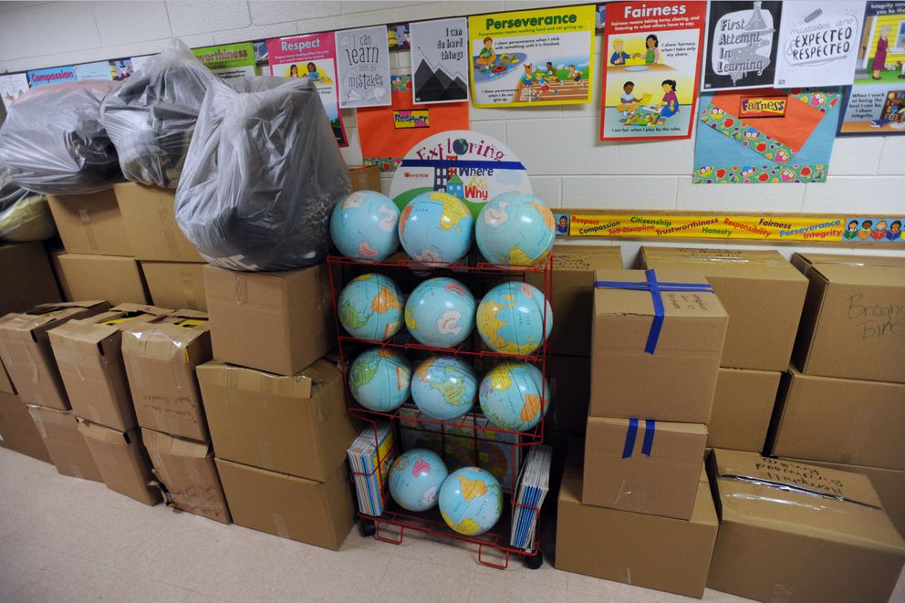 Classroom supplies ready to be moved are stacked in a hallway at the earthquake-damaged Eagle River Elementary on Thursday. (Bill Roth / ADN)