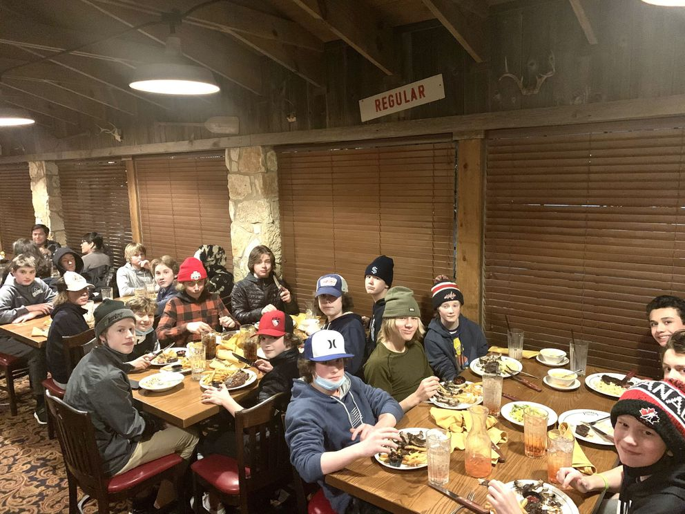 Members of the Alaska Oilers and Alaska Stars share their first hot meal in days Tuesday night at a steakhouse in Austin, Texas, which was slammed by an unprecedented winter storm that shut down the city. (Photo by Chris Heisten)