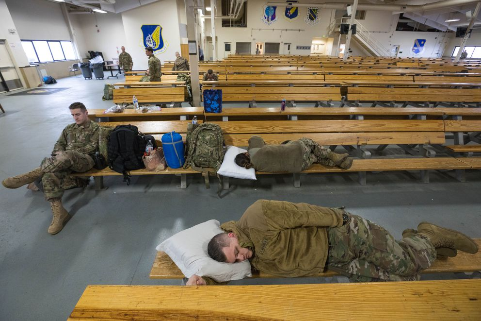Members of the Alaska Air National Guard 176th Wing nap before their deployment to the Middle East on Tuesday. (Loren Holmes / Alaska Dispatch News)