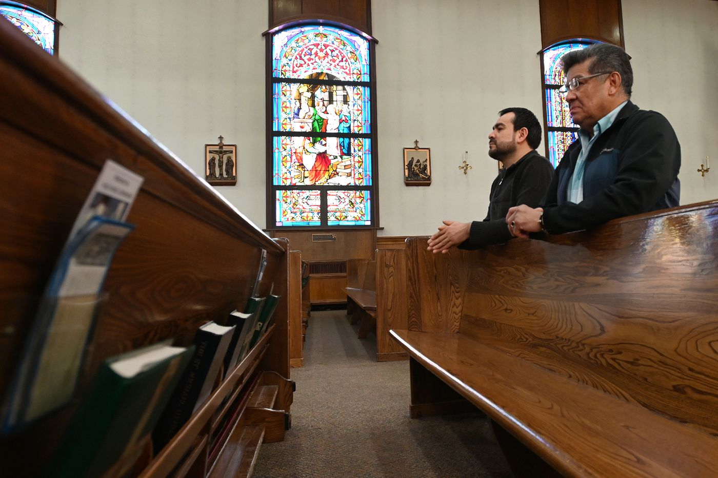 MARCH 15. Alfonzo Seqouiano and Eduardo Rocha kneel while praying at Holy Family Cathedral in downtown Anchorage. Rocha said, 'I prayed for people all around the world with the coronavirus. ' According to a message on the front door, all public liturgies, including masses, have been suspended until Friday, March 27, 'as a precaution in preventing the spread of COVID-19 ' The cathedral is open for private prayer. (Bill Roth / ADN)