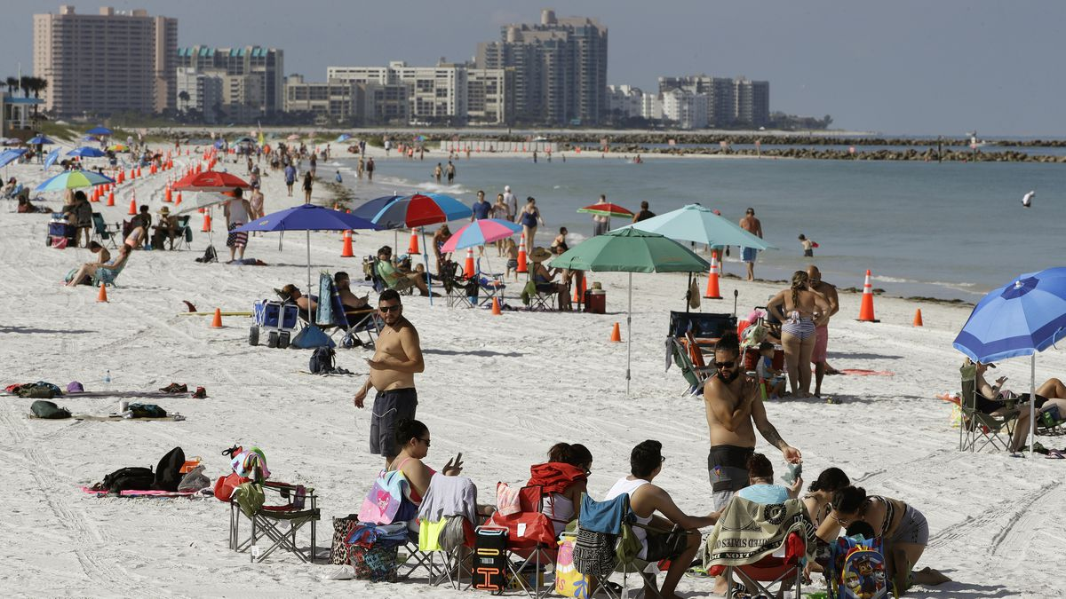 Cones are set up to help beachgoers keep a safe distance from one another after Clearwater Beach officially reopened to the public Monday, May 4, 2020, in Clearwater Beach, Fla. Many public beaches and restaurants are reopening as part of Florida Gov. Ron DeSantis' plan to stop the spread of the coronavirus. (AP Photo/Chris O'Meara)