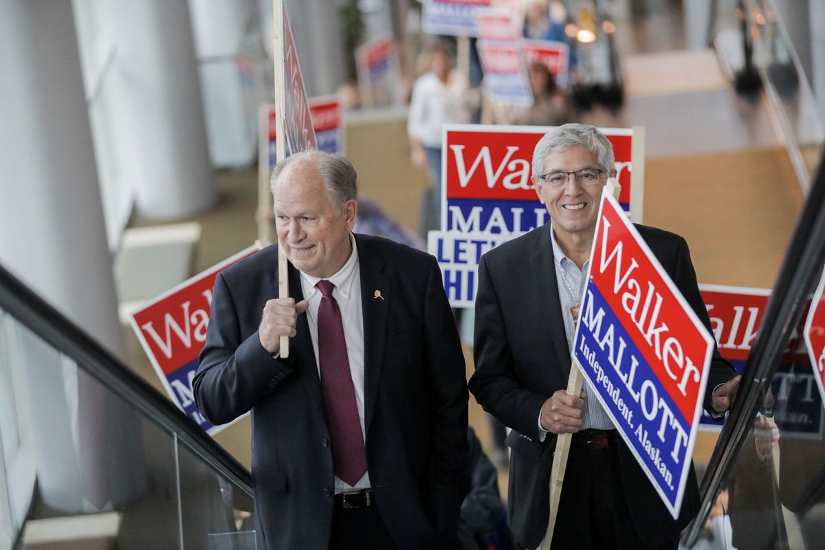 Bill Walker and Byron Mallott arrive at the Dena'ina Civic and Convention Center on Tuesday night, Aug. 21, 2018. (Loren Holmes / ADN)