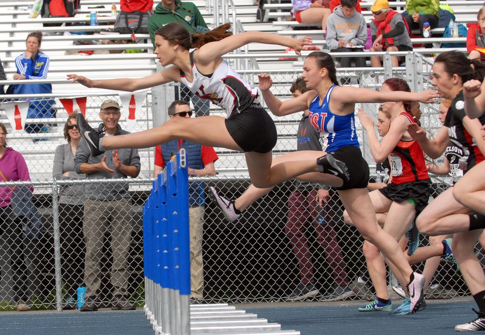 Kenai Central's Savanna Wilson leads over the first hurdle en route to victory in the Division II girls 100 meter hurdles race at the ASAA/First National Bank Alaska Division I Track and Field Championships at Machetanz Field in Palmer on Saturday, May 25, 2019. (Matt Tunseth / ADN)