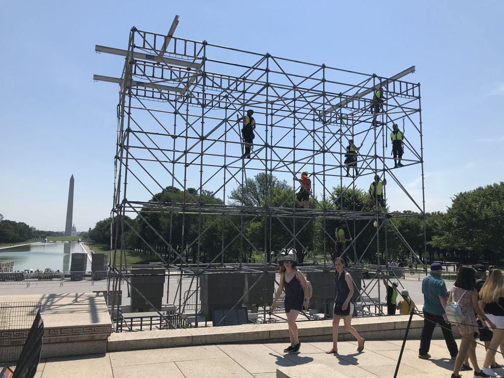 Workers build the stage and bleachers on June 28 for President Trump's July Fourth celebration and address from the steps of the Lincoln Memorial. (Washington Post photo by Michael E. Ruane)