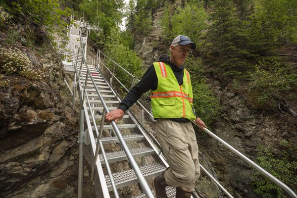 Brad Meiklejohn, Alaska director for The Conservation Fund, walks down a staircase into Eklutna canyon to the site of a nearly 90-year-old, unused dam on Wednesday. The Conservation Fund and Eklutna Inc. are dismantling the dam this summer, with the hopes of restoring salmon runs. (Loren Holmes / Alaska Dispatch News)