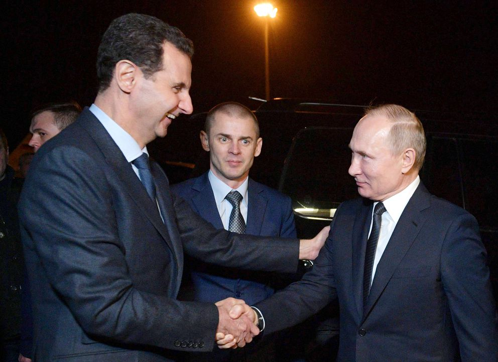 Russian President Vladimir Putin, right, and Syrian President Bashar Assad shake hands during their meeting in Damascus, Syria, Tuesday, Jan. 7, 2020. Putin has traveled to Syria to meet with President Bashar Assad, a key Iranian ally. The rare visit Tuesday comes amid soaring tensions between Iran and the United States following the U.S. drone strike last week that killed a top Iranian general who led forces supporting Assad in Syria's civil war. (Alexei Druzhinin, Sputnik, Kremlin Pool Photo via AP)