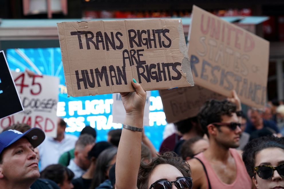 People protest President Donald Trump's announcement that he plans to reinstate a ban on transgender individuals from serving in any capacity in the U.S. military, in Times Square, in New York on July 26, 2017. (Carlo Allegri / Reuters file)