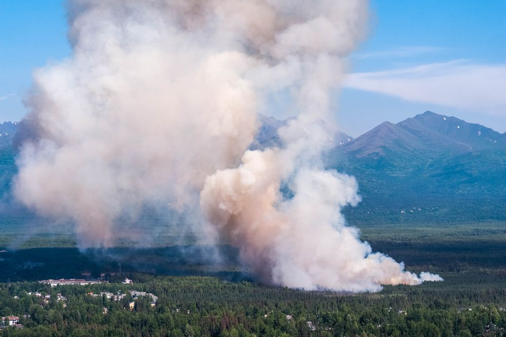A brush fire burns in South Anchorage Tuesday, July 2, 2019. (Loren Holmes / ADN)