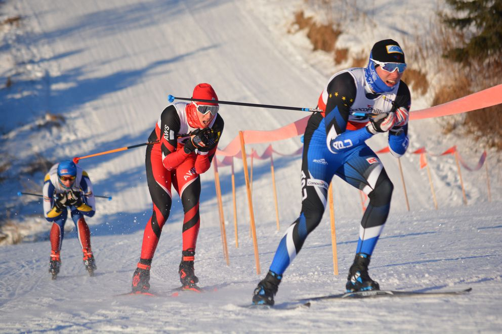 L to R - Miles Dennis (ANR-Alaska Nordic Racing), Eli Hermanson (AWS-Alaska Winter Stars), Julien Bordes (APUNSC-Alaska Pacific University Nordic Ski Center) in the semifinal heat of the the men's sprint on Saturday, 1/19. Photo by Laarni Power