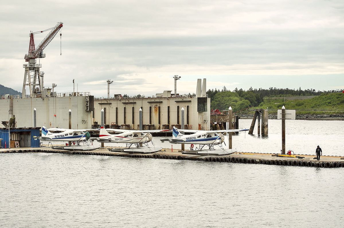 A worker tends to a vacant float plane slip at the Taquan Air docks near the Vigor Alaska shipyard in Ketchikan, Alaska, Tuesday, May 21, 2019. The Alaska air carrier involved in two deadly floatplane crashes in a week has voluntarily suspended operations, federal officials said Tuesday. (Dustin Safranek/Ketchikan Daily News via AP)