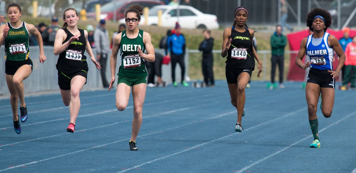 Delta Junction's Hailey Williams (third from left) runs to victory in the girls 100 meters Saturday at the Palmer Relays. Williams won in 12.29 seconds and Palmer's Teeana Nicholai (far right) was second in 12.85. (Photo by Stephen Nowers)