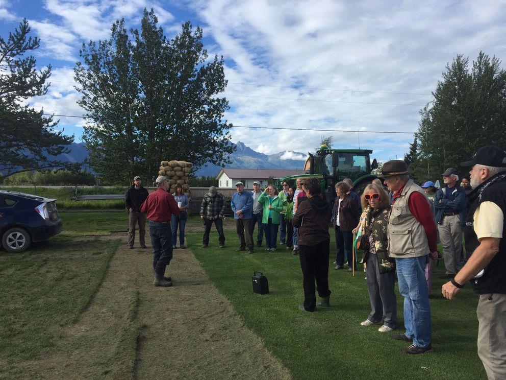 People learn about a Mat-Su farm during the Mat-Su Farm Bureau's annual tour. The ninth annual tour will be Aug. 2 (Photo by Margaret Adsit)