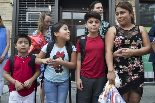 Yeni Gonzalez, right, stands with her children Lester, 11, second from right, and Jemelin, 9, second from left, and Deyuin, 6, during a news conference outside the Cayuga Center, Friday, July 13, 2018, in New York. Gonzalez, who was separated from her three children at the U.S.-Mexico border, was reunited on Tuesday at the social services center. (AP Photo/Mary Altaffer)