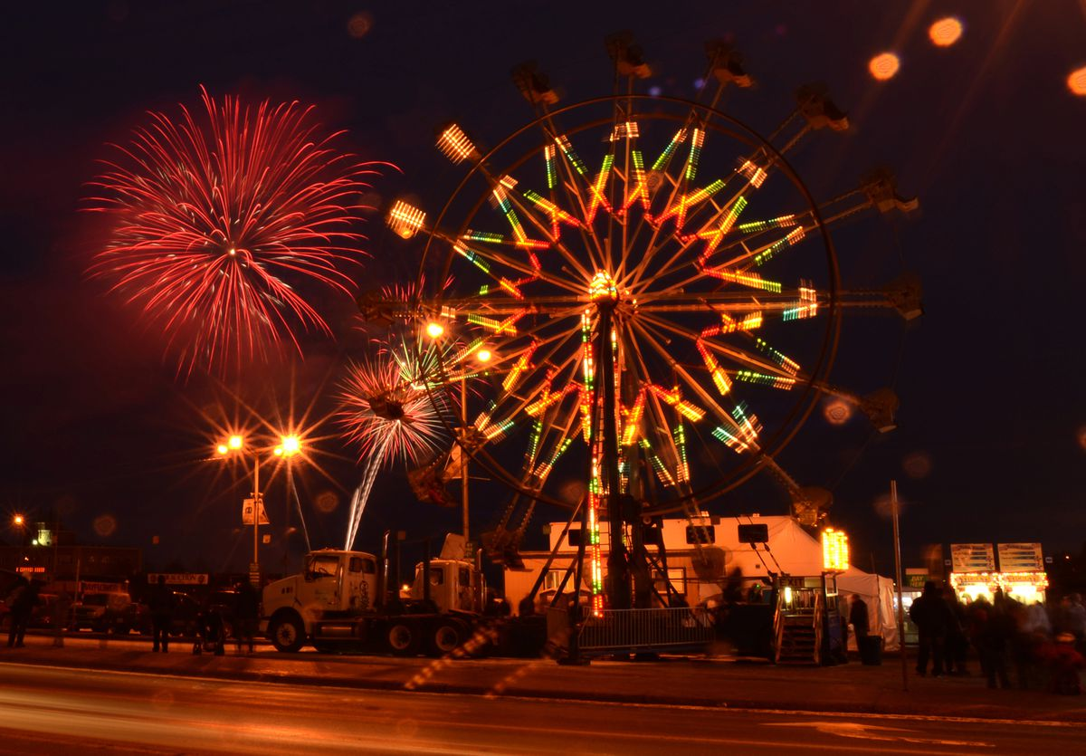 The Rondy fireworks explode in the sky over the Ferris wheel at the Rondy Carnival in downtown Anchorage on the first weekend of the Anchorage Fur Rondy 2015. (Bob Hallinen / ADN archive)