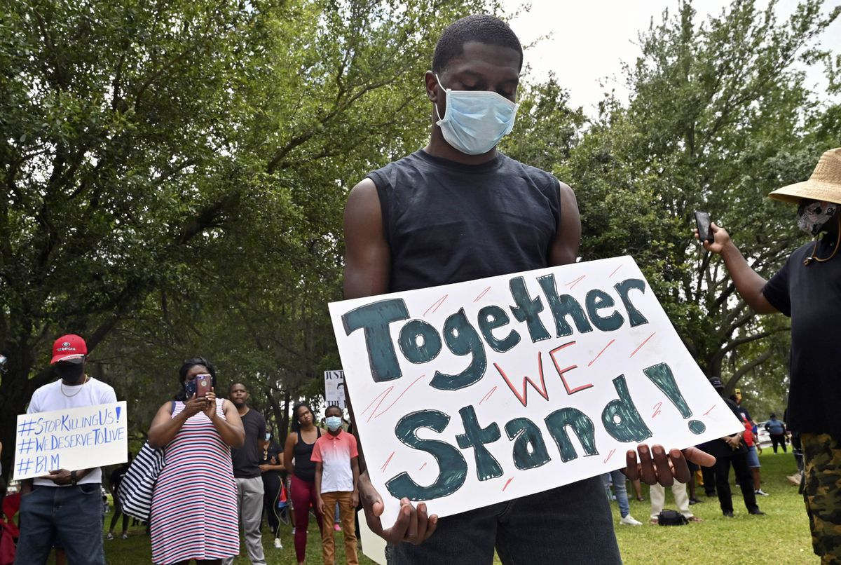 Protesters gather outside the Glynn County Courthouse during a rally to protest the shooting of Ahmaud Arbery, Saturday, May 16, 2020, in Brunswick, Ga. (Hyosub Shin/Atlanta Journal-Constitution via AP)