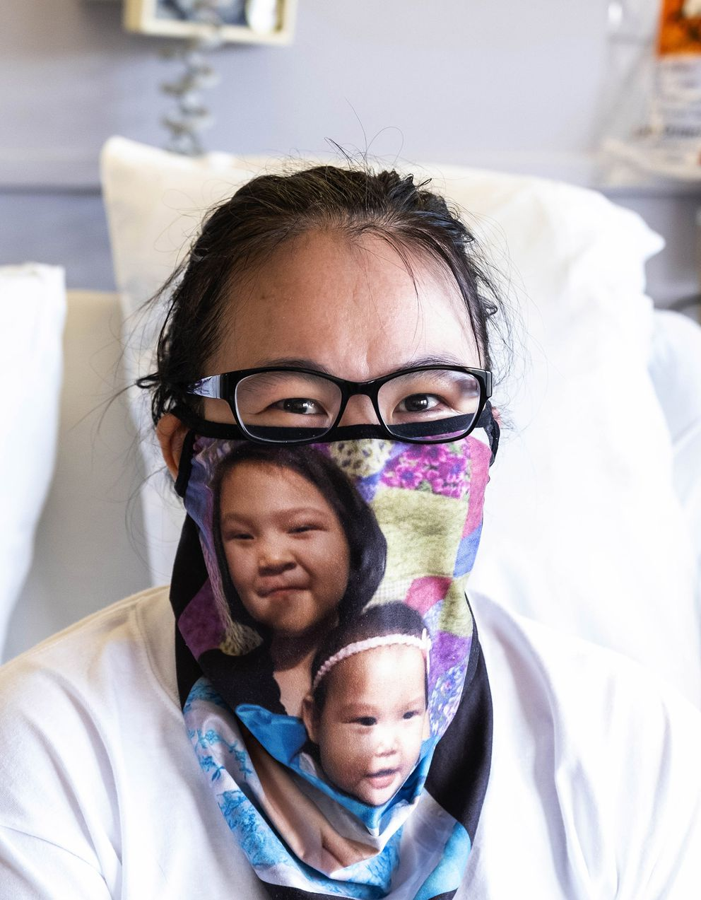 Nastasia Xavier contracted Covid in her small town in Alaska at Thanksgiving, and has been in hospitals in Alaska and Seattle ever since. She wears a mask she made herself of her two children - Leona, 13; and Sasha, 5 - to remind her of the family she has left behind. Sheís due to begin her journey home Thursday, Feb. 4, 2021. (Photo by Dean Rutz / Seattle Times) Photographed February 3, 2021 216300