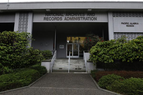This Jan. 23, 2020, photo shows the National Archives on Sand Point, Wash., that has about a million boxes of generally unique, original source documents and public records. More than two dozen Native American tribes and cultural groups from the Northwest and Alaska are suing the federal government to stop the sale of the National Archives building in Seattle, a plan that would force the relocation of millions of invaluable historical records to California and Missouri. (Alan Berner/The Seattle Times via AP)