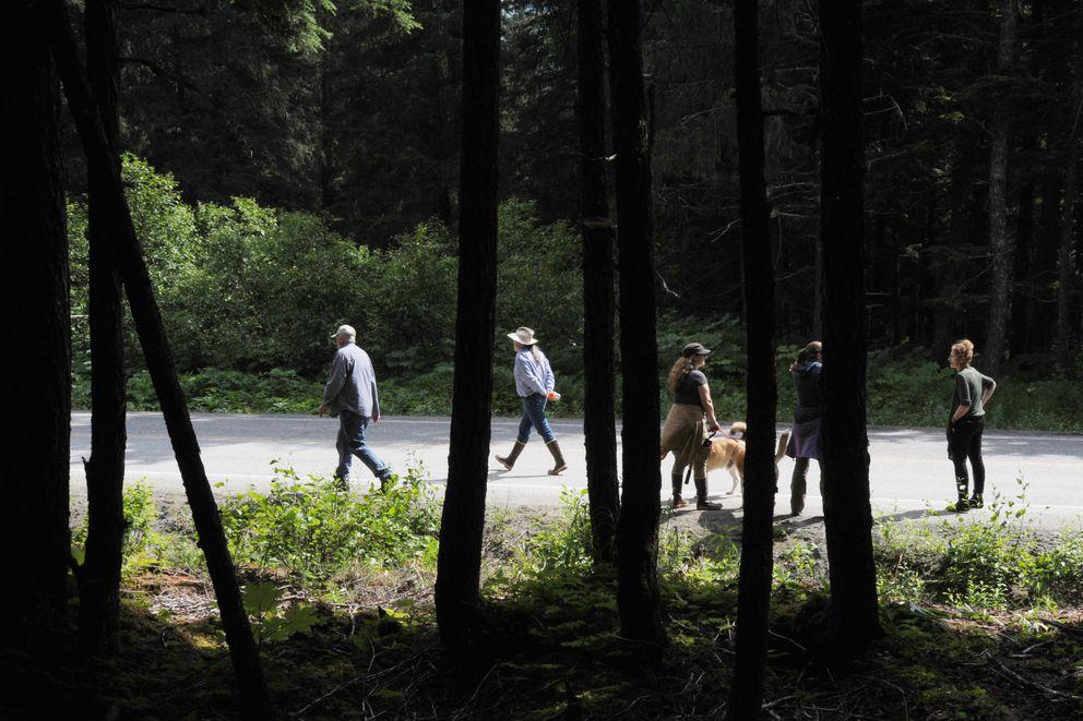 Girdwood residents walk along Crow Creek Road afterthe open house. (Bill Roth / Alaska Dispatch News)