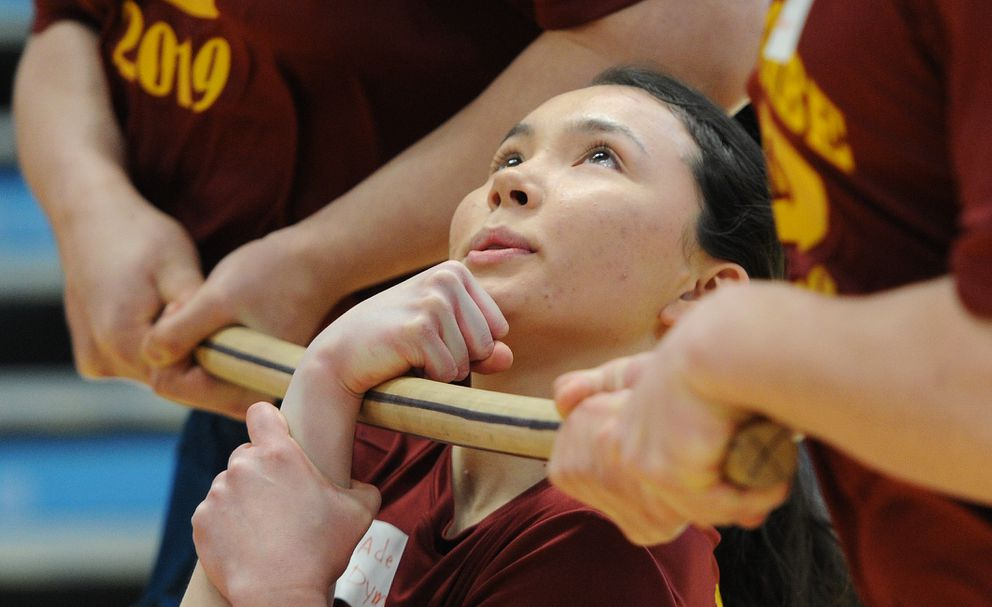 Adeline Dyment, 17, of Bethel competed for Mt. Edgecumbe in the wrist carry event on the first day of the Native Youth Olympics in the Alaska Airlines Center on Thursday, April 24, 2019. (Bill Roth / ADN)