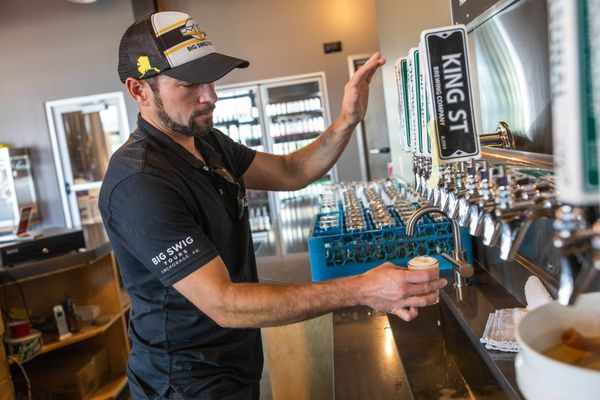 Big Swig Tours owner Bryan Caenepeel pours samples of beer Tuesday, June 26, 2018 at King Street Brewing Company. Tour patrons were on a four hour tour of three local breweries. (Loren Holmes / ADN)