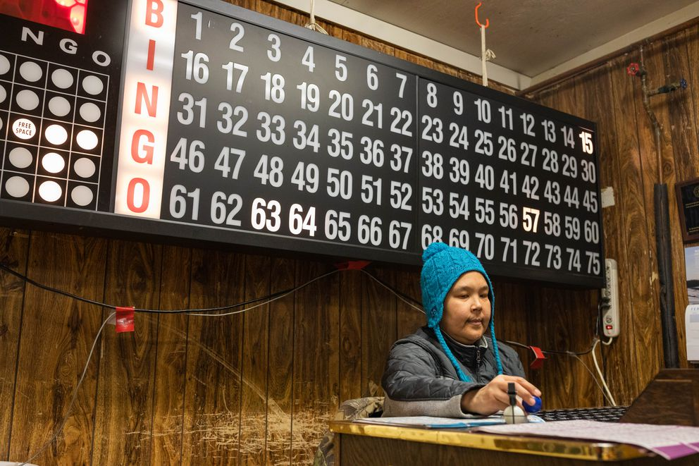 Bingo caller April Pitka works a game at the bingo hall. (Loren Holmes / ADN)