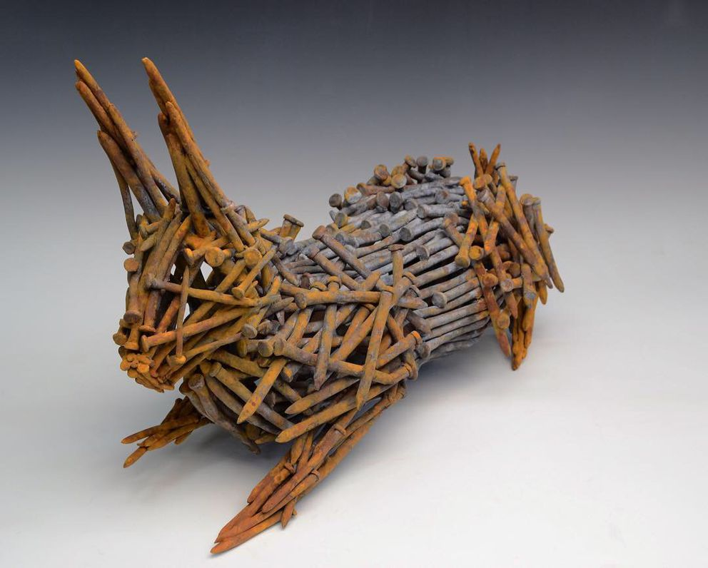 Rabbit sculpture made of rusted nails by Fekete.