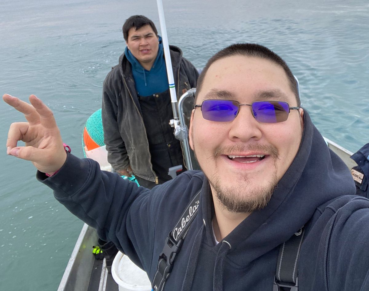 Josiah Patkotak (foreground) is seen with his younger brother, Samuel, on Sept. 5, 2020 while bowhead whale hunting off the coast of Utqiagvik. Josiah, an independent candidate for House District 40, has been quarantined in Anchorage after a positive COVID-19 test. (Josiah Patkotak photo)