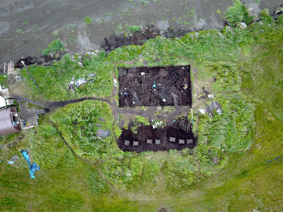 The Nunalleq archaeological site is viewed from above in August near Quinhagak. At the end of the excavation season, the site gets filled in for the winter, and sandbags are packed against the eroding embankment. (Sven Haakanson)