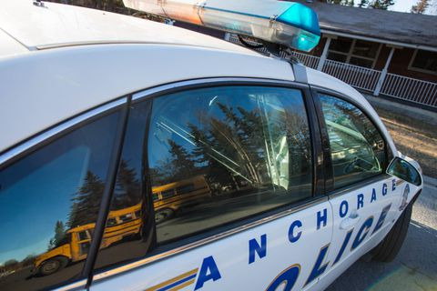 LOREN HOLMES / Alaska Dispatch News Anchorage School District busses were re-routed around Peck Ave. on Thursday morning, Apr. 21, 2016. Police were responding to an armed barricaded subject in an apartment complex.