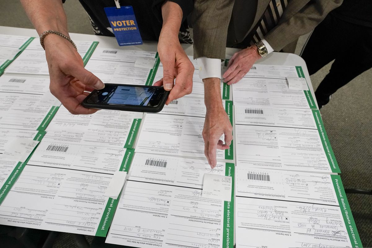 FILE - In this Nov. 6, 2020, photo, a canvas observer photographs Lehigh County provisional ballots as vote counting in the general election continues in Allentown, Pa. President Donald Trump's campaign filed a number of lawsuits across six battleground states this month as he tried to upend the 2020 election. Judges uniformly rejected his claims of vote fraud. The latest case ended Saturday, Nov. 21, when a federal judge in Pennsylvania said Trump lawyer Rudy Giuliani presented only 'speculative accusations' that brought to mind 'Frankenstein's Monster.' (AP Photo/Mary Altaffer, File)