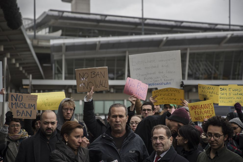 Hameed Khalid Darweesh, center, a former interpreter for the U.S. military in Iraq, speaks after his release from detention during a protest outside John F. Kennedy International Airport on Saturday. (Victor J. Blue/The New York Times)