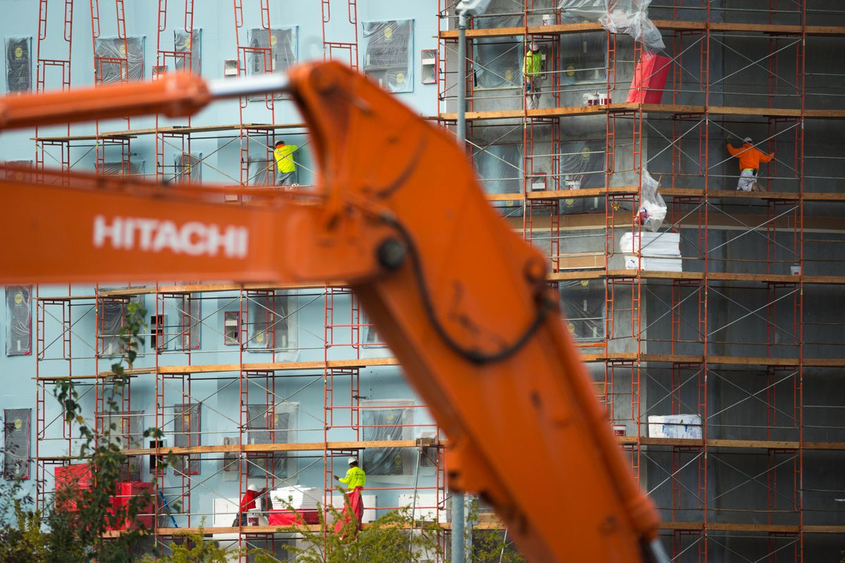 Workers scale scaffolding at a new Hyatt hotel in Midtown Anchorage on Thursday, Sept. 8, 2016. (Loren Holmes / Alaska Dispatch News)