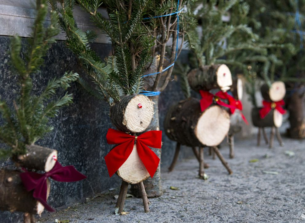 Model reindeer made from tree trunks and twigs sit along the sidewalk at the Gilmartin's Christmas tree stand on West 22nd Street and 9th Avenue in New York City. (Taylor Balkom / taylorbalkom.com)