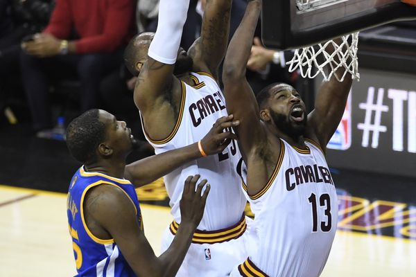 Jun 9, 2017; Cleveland, OH, USA; Cleveland Cavaliers forward LeBron James (23) dunks the ball from behind center Tristan Thompson (13) as Golden State Warriors forward Kevin Durant (35) looks on during the second half in game four of the 2017 NBA Finals at Quicken Loans Arena. Mandatory Credit: Kyle Terada-USA TODAY Sports