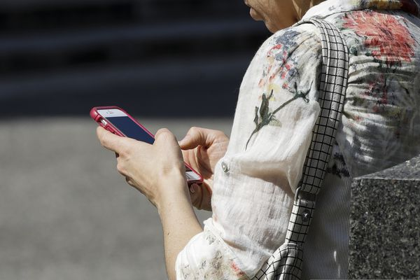 FILE - In this April 8, 2019, file photo, a woman browses her smartphone in Philadelphia. Accidental cuts and bruises to the face, head and neck from cellphones are sending increasing numbers of Americans to the emergency room, according to a study that estimates 76,000 cases over nine years. (AP Photo/Matt Rourke, File)