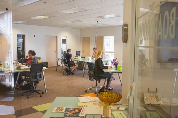 People work independently in the shared space of the Boardroom, a coworking space in Anchorage on Thursday, July 28, 2016. (Loren Holmes / Alaska Dispatch News)
