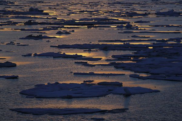 FILE - In this July 21, 2017 file photo, the sun sets over sea ice floating on the Victoria Strait along the Northwest Passage in the Canadian Arctic Archipelago. After 24 days at sea and a journey spanning more than 10,000 kilometers (6,214 miles), the Finnish icebreaker MSV Nordica has set a new record for the earliest transit of the fabled Northwest Passage. The once-forbidding route through the Arctic, linking the Pacific and the Atlantic oceans, has been opening up sooner and for a longer period each summer due to climate change. Sea ice that foiled famous explorers and blocked the passage to all but the hardiest ships has slowly been melting away in one of the most visible effects of man-made global warming. (AP Photo/David Goldman, File)