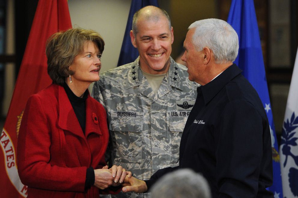 Sen. Lisa Murkowski greets Vice President Mike Pence during his visit to Joint Base Elmendorf-Richardson during a refueling stop on Veterans Day on Sunday. Lt. Gen. Thomas Bussiere, center, is the senior military officer in Alaska. (Bill Roth / ADN)