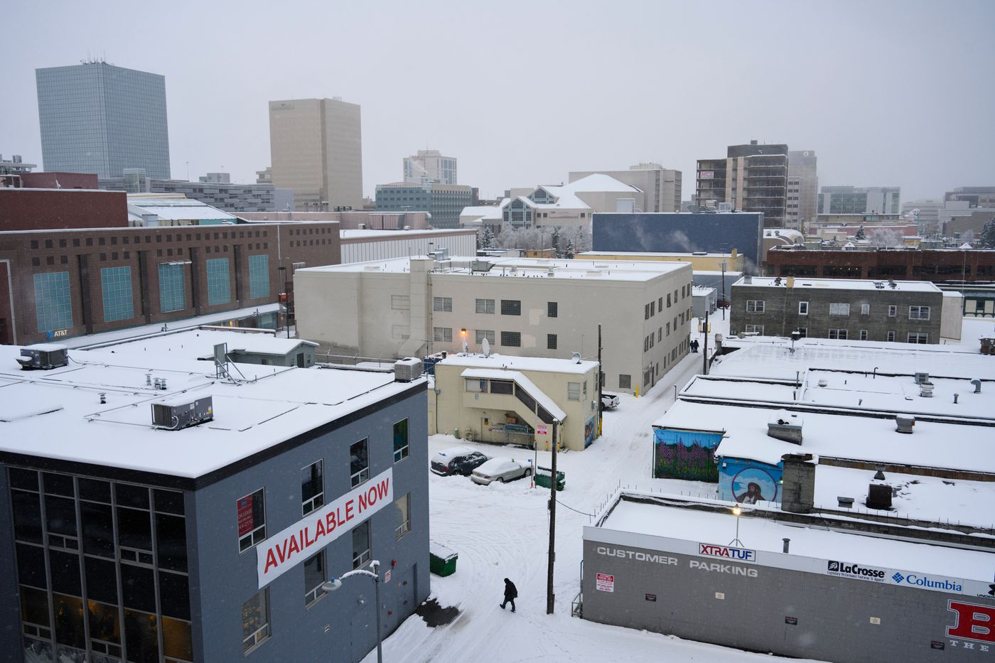 A pedestrian crosses an alleyway in downtown Anchorage on November 12, 2020. (Marc Lester / ADN)