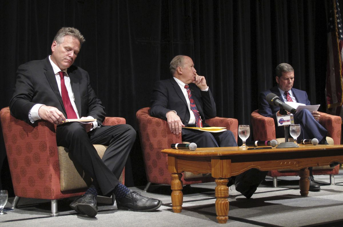 The major candidates for governor in Alaska are shown on stage before the start of a chamber of commerce forum on Thursday, Sept. 6, 2018, in Juneau. Shown from left, Republican nominee Mike Dunleavy, former state senator; Gov. Bill Walker, an independent; and Democratic nominee Mark Begich, a former U.S. senator. (AP Photo/Becky Bohrer)
