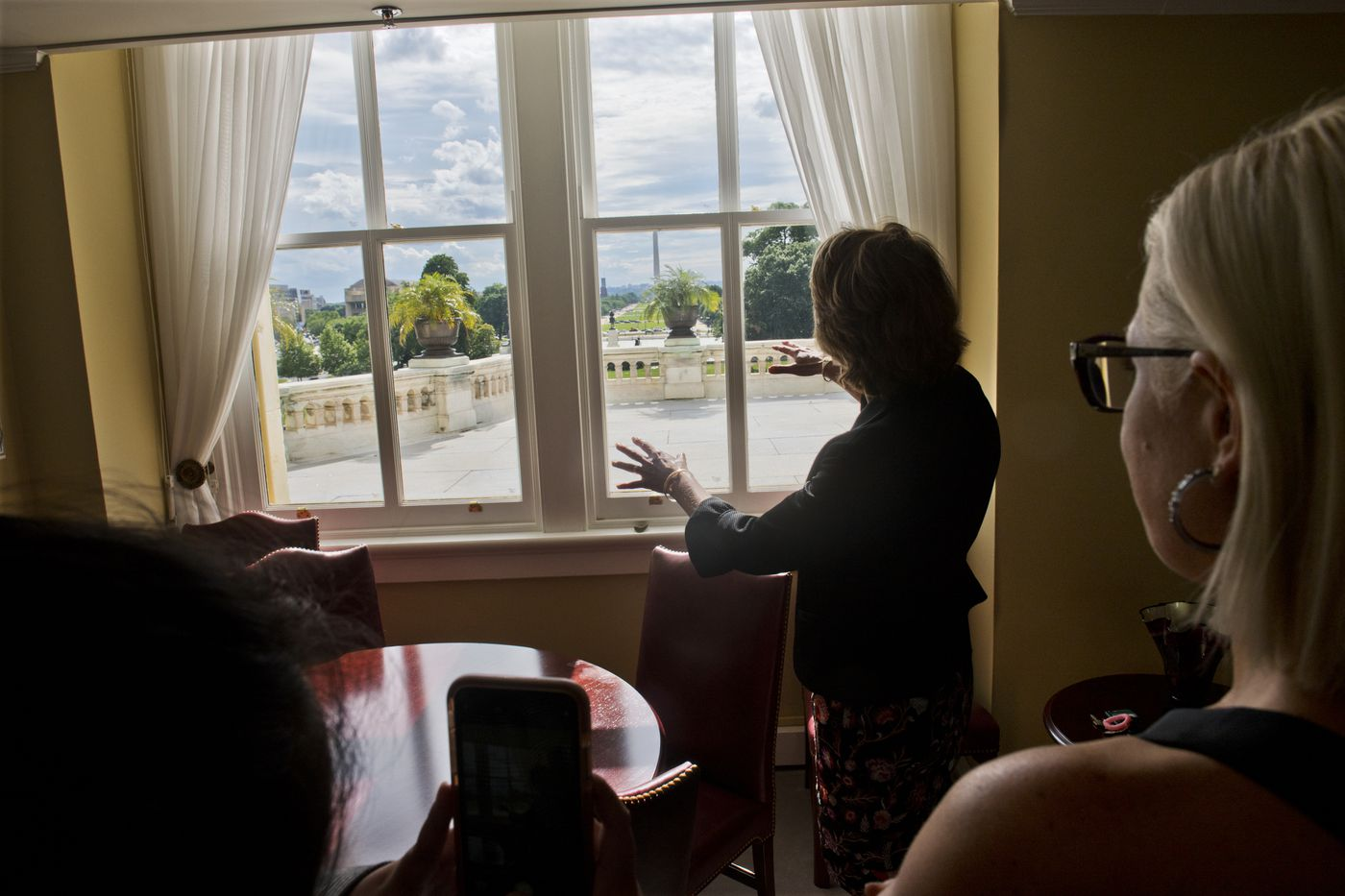 Sen. Lisa Murkowski looks at the view of the National Mall from her hideaway office in the Capitol on June 18, 2019. (Marc Lester / ADN)