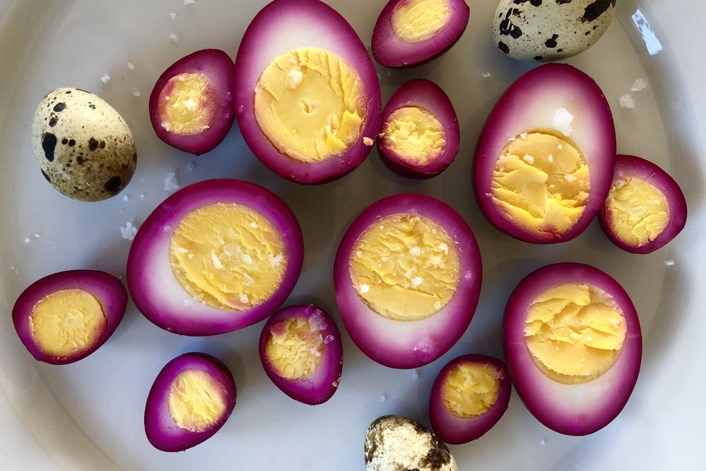 Hen and quail eggs pickled with Alaska beets and spices. (Julia O'Malley / ADN)