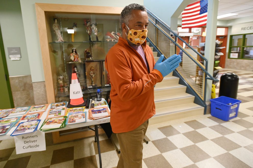 Sand Lake Elementary principal Linson Thompson inside the school as students picked up their personal belongings in the parking lot on Tuesday, May 5, 2020, during the COVID-19 pandemic. (Bill Roth / ADN)