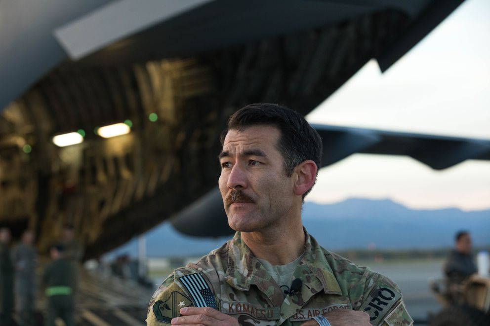 Lt. Col. Matthew Komatsu, executive officer to Adjutant General Maj. Gen. Laurie Hummel, stands next to a Alaska Air National Guard C-17 Wednesday, Sept. 12, 2018 at Joint Base Elmendorf-Richardson. Komatsu is a combat rescue officer and will lead rescue teams on the U.S. east coast in support of hurricane Florence relief efforts. (Loren Holmes / ADN)