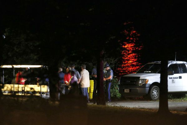 Rescue crews work at the scene of a deadly boat accident at Table Rock Lake in Branson, Mo., Thursday, July 19, 2018. A sheriff in Missouri said a tourist boat has apparently capsized on the lake, leaving several people dead and several others hospitalized. (Andrew Jansen/The Springfield News-Leader via AP)