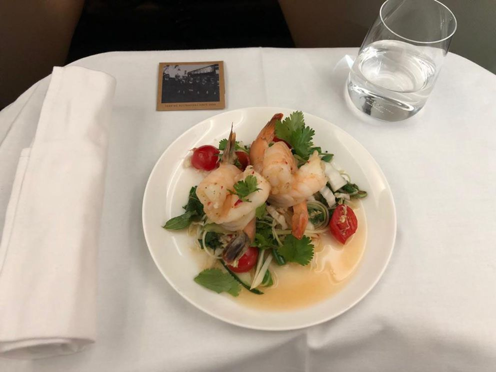 Poached prawns with chili and lime, designed to wake passengers up. (Angus Whitley/Bloomberg)