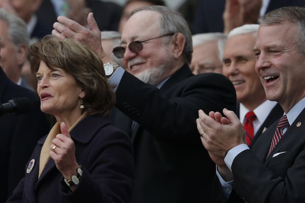 From left, Sen. Lisa Murkowski, Rep. Don Young and Sen. Dan Sullivan applaud during an event with Republican lawmakers to mark passage of sweeping tax overhaul legislation at the White House in Washington on Dec. 20, 2017. (Carlos Barria / Reuters)
