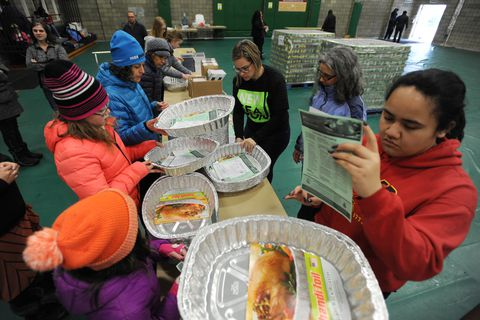 Volunteers prepare the Spenard Community Recreation Center on Sunday, Nov. 19, 2017, one of six sites in the Anchorage and Eagle River, for the annual Thanksgiving Blessing food distribution of groceries, including a turkey and all the fixings, to thousands of families in need to make a Thanksgiving meal. The Food Bank of Alaska, its partners, and volunteers from the faith-based community will distribute food on Monday, Nov. 20, 2017, from 3 p.m. - 8 p.m. For more info visit www.foodbankofalaska.org, or dial 2-1-1. (Bill Roth / ADN)